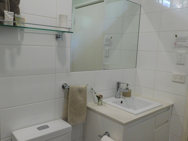 Ensuite with hairdryer, heatlamps & toiletries